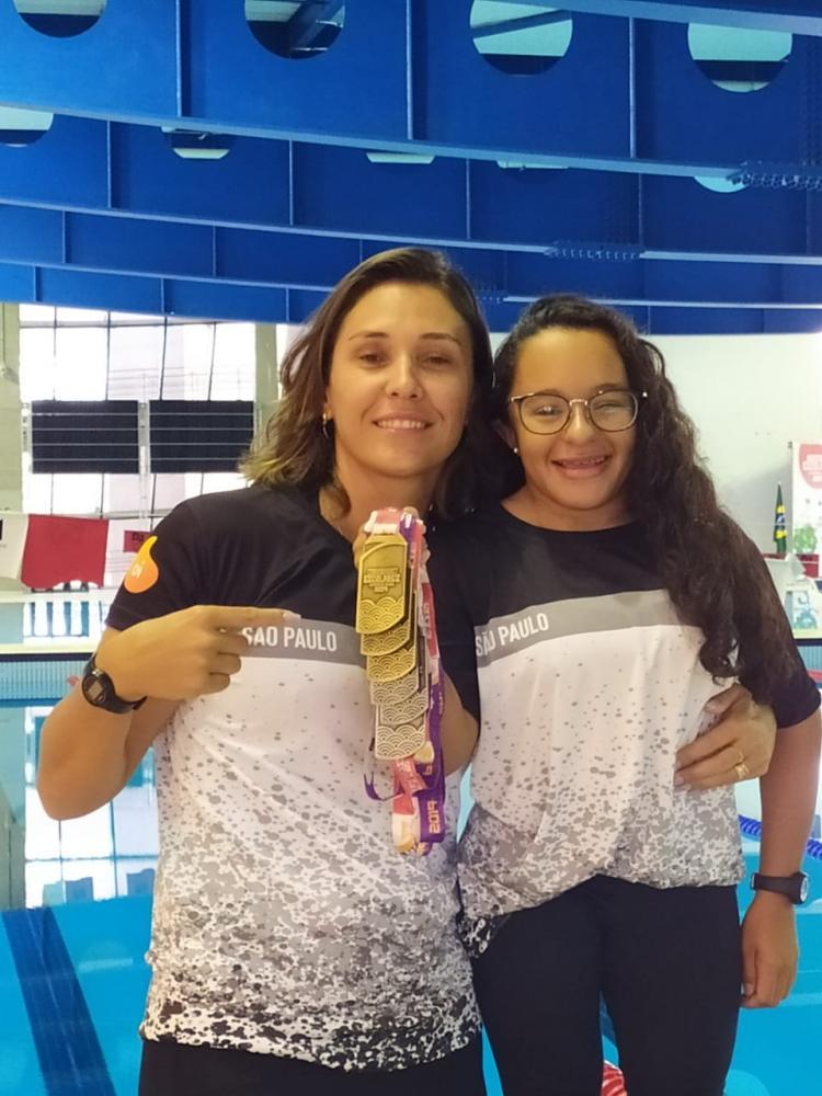 Cedida - Micheline e Dayara, treinadora e aluno compartilham de várias experiências juntas