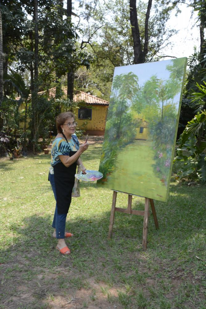 Elisabete Santos - Embora a paisagem seja sua temática predominante, a artista pinta flores e frutas com o mesmo fervor
